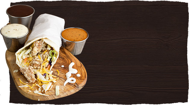 Wood table background with burrito on side